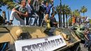 "Cast members Dolph Lundgren, Jason Statham, Harrison Ford, Mel Gibson, Ronda Rousey, Sylvester Stallone, Wesley Snipes pose on a tank as they arrive on the Croisette to promote the film ""The Expe"