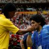 FILE PHOTO: Former Argentine soccer player Diego Maradona kisses the hand of Ronaldinho of Brazil after the medal ceremony for men's soccer at the Beijing 2008 Olympic Games