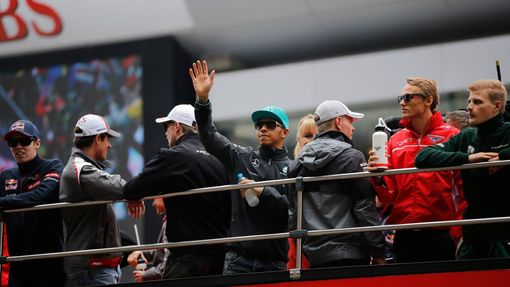 Mercedes Formula One driver Lewis Hamilton of Britain waves from a bus during the drivers' parade before the Chinese F1 Grand Prix at the Shanghai International circuit,
