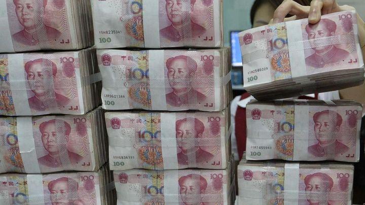 Bankéři: Ruské firmy chystají přechod od dolarů na jüany