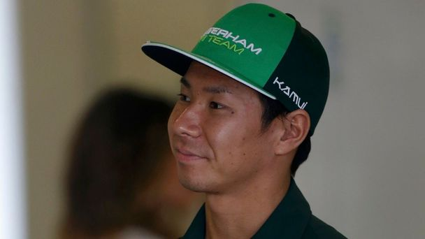 Caterham Formula One driver Kobayashi of Japan looks on in the garage during the second practice session of the Australian F1 Grand Prix in Melbourne