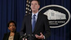 FBI Director James Comey speaks next to U.S. Attorney General Loretta Lynch at a news conference at the Justice Department in Washington