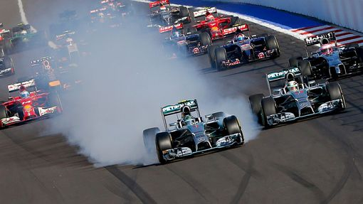 Mercedes Formula One driver Nico Rosberg of Germany leads next to Mercedes Formula One driver Lewis Hamilton of Britain (R) after the start of the first Russian Grand Pri