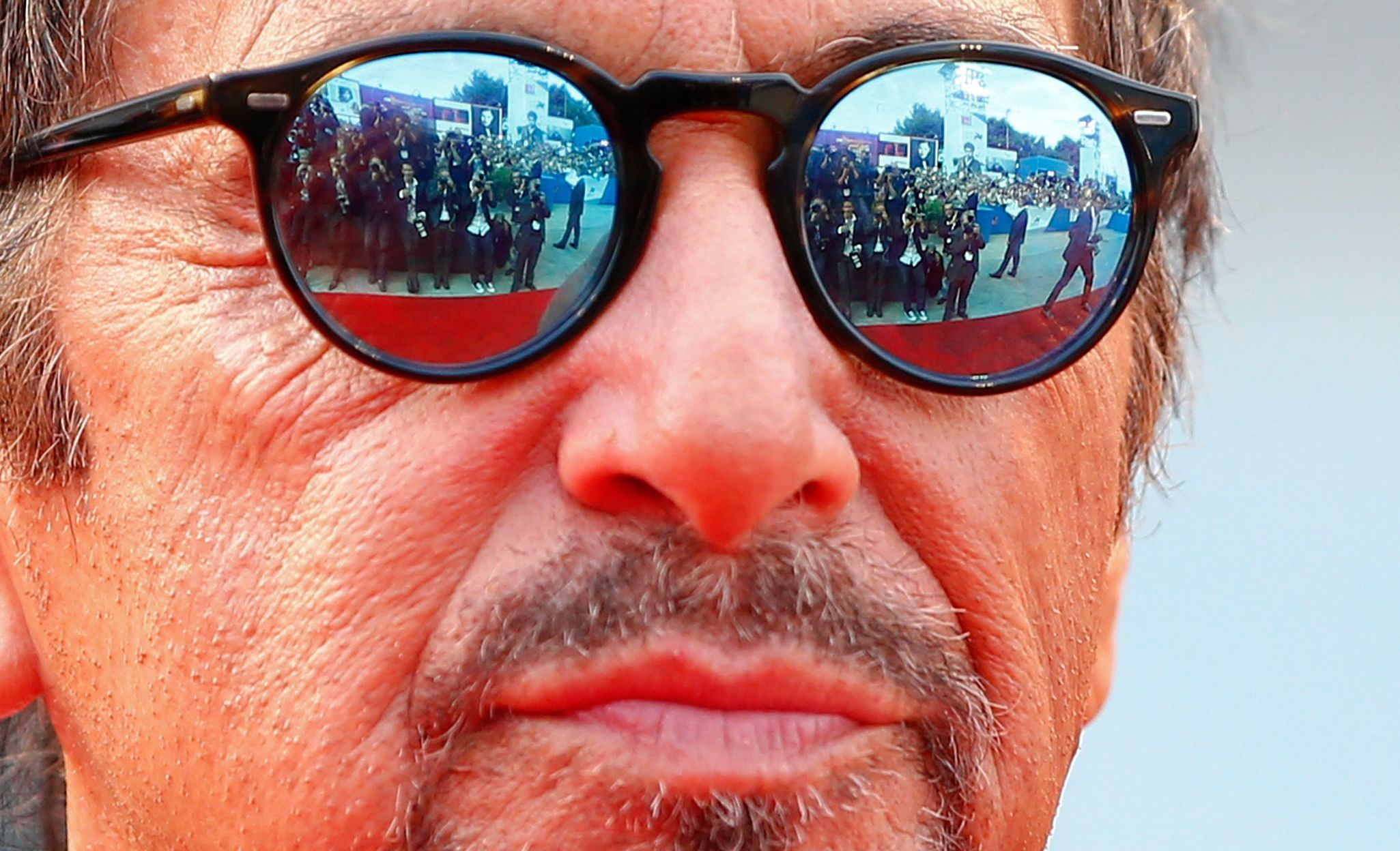 "Members of the media are reflected in the sunglasses of cast member Al Pacino as he attends the red carpet for the movie ""Manglehorn"" at the Venice Film Festival"