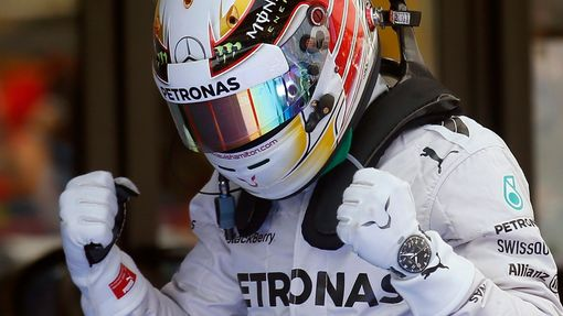 Mercedes Formula One driver Lewis Hamilton of Britain celebrates after taking the pole position at the qualifying session of the Spanish F1 Grand Prix at the Barcelona-Ca