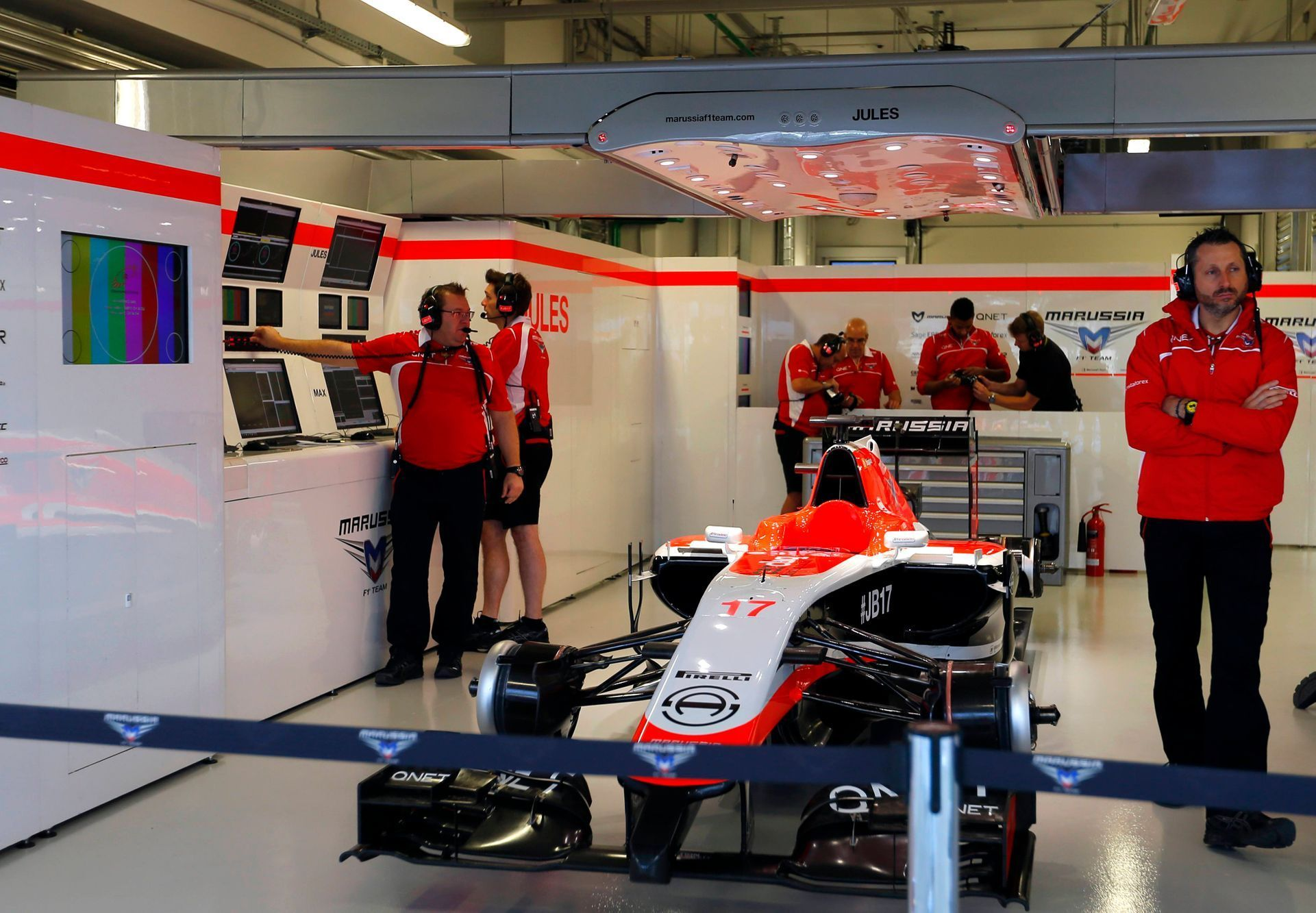 The car of Marussia Formula One driver Jules Bianchi of France is pictured in the garage during the first free practice session of the  Russian F1 Grand Prix in the Sochi Autodrom circuit