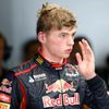 Toro Rosso Formula One driver Verstappen of the Netherlands returns to the garage after his car stalled on the track during the first practice session of the Japanese F1 Grand Prix at the Suzuka Circu