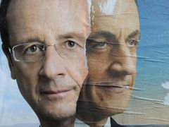 Official campaign posters for Sarkozy and Hollande for the French presidential election are displayed on a wall in Paris