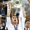 Real Madrid's Cristiano Ronaldo celebrates with the trophy after winning the UEFA Champions League