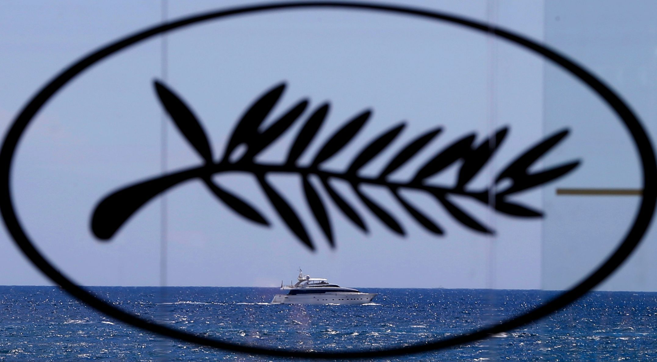 A yacht is seen in the Bay of Cannes through a Palme d'Or symbol on the eve of the opening of the 67th Cannes Film Festival in Cannes