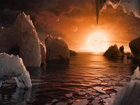 Vědci objevili soustavu planet, na nichž může být voda i život. Obíhají kolem červeného trpaslíka