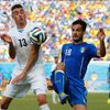 Uruguay's Jose Maria Gimenez fights for the ball with Italy's Marco Parolo during their 2014 World Cup Group D soccer match at the Dunas arena