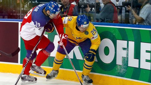 Sweden's Erik Gustafsson (L) is checked into the boards by Jan Kolar of the Czech Republic (R) during the first period of their men's ice hockey World Championship bronze