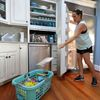 Michelle Stober, of Cary, N.C., removes food from a freezer as she prepares their vacation home in advance of Hurricane Florence in Wrightsville Beach, N.C.