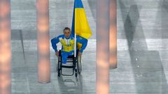Ukraine's flag-bearer Tkachenko arrives in the stadium during the opening ceremony of the 2014 Paralympic Winter Games in Sochi