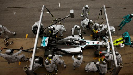 Crew members of Mercedes Formula One driver Lewis Hamilton of Britain service the car at pit stop during the Spanish F1 Grand Prix at the Barcelona-Catalunya Circuit in M