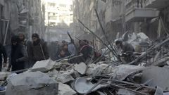 Residents inspect damage after airstrikes by pro-Syrian government forces in the rebel held Al-Shaar neighborhood of Aleppo, Syria