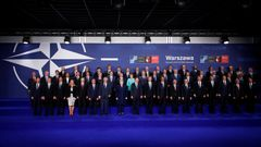 NATO heads of state and other leaders participate in a family photo at the NATO Summit in Warsaw, Poland