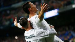 Real Madrid's Cristiano Ronaldo celebrates scoring their third goal and his hat-trick with Sergio Ramos