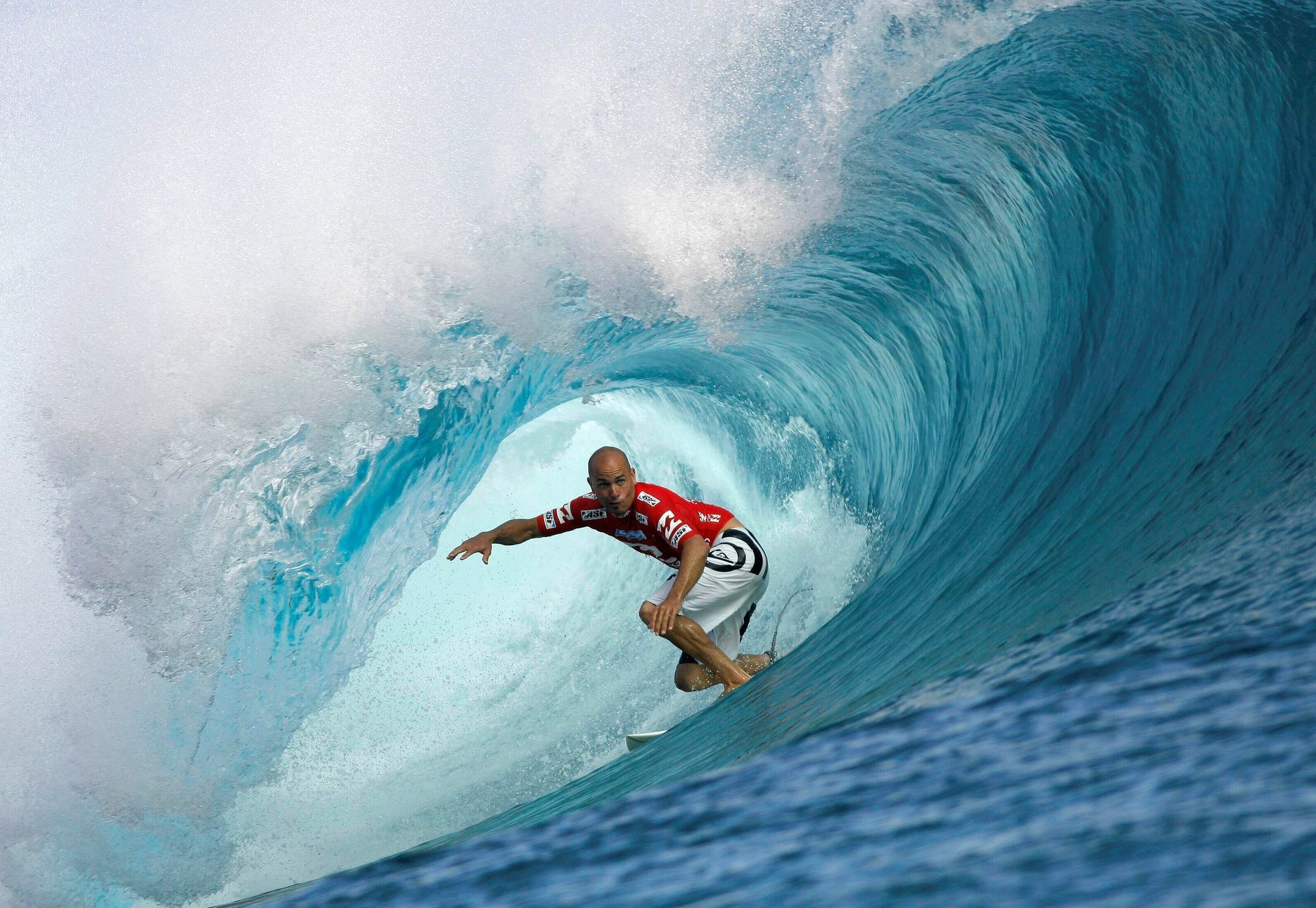 FILE PHOTO: Surfer Slater of the U.S rides a wave during the third round of competition in the Billabong Pro surfing tournament on the legendary reef break in Teahupoo