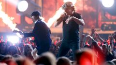 Johnson and Young of AC/DC perform a medley of songs to open the show at the 57th annual Grammy Awards in Los Angeles
