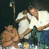 Diego Maradona smokes a cigar with former Reuters Cuba correspondent Andrew Cawthorne in Havana