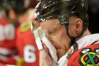 Blackhawks Marian Hossa cools off at the bench during overti