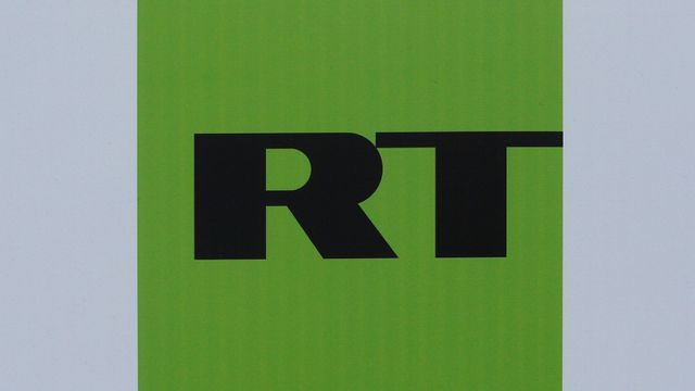 FILE PHOTO: The logo of Russian television network Russia Today (RT) is seen on a board at the St. Petersburg International Economic Forum 2017  in St. Petersburg, Russia