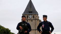 French CRS police stand guartd in front of the church a day after a hostage-taking in Saint-Etienne-du-Rouvray near Rouen in Normandy