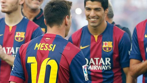 FC Barcelona's player Suarez smiles to teammate Messi during their team presentation at Nou Camp stadium in Barcelona