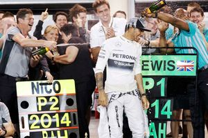 Mercedes Formula One driver Lewis Hamilton of Britain is sprayed with champagne by his team after his win in the Bahrain F1 Grand Prix at the Bahrain International Circuit (BIC) in Sakhir