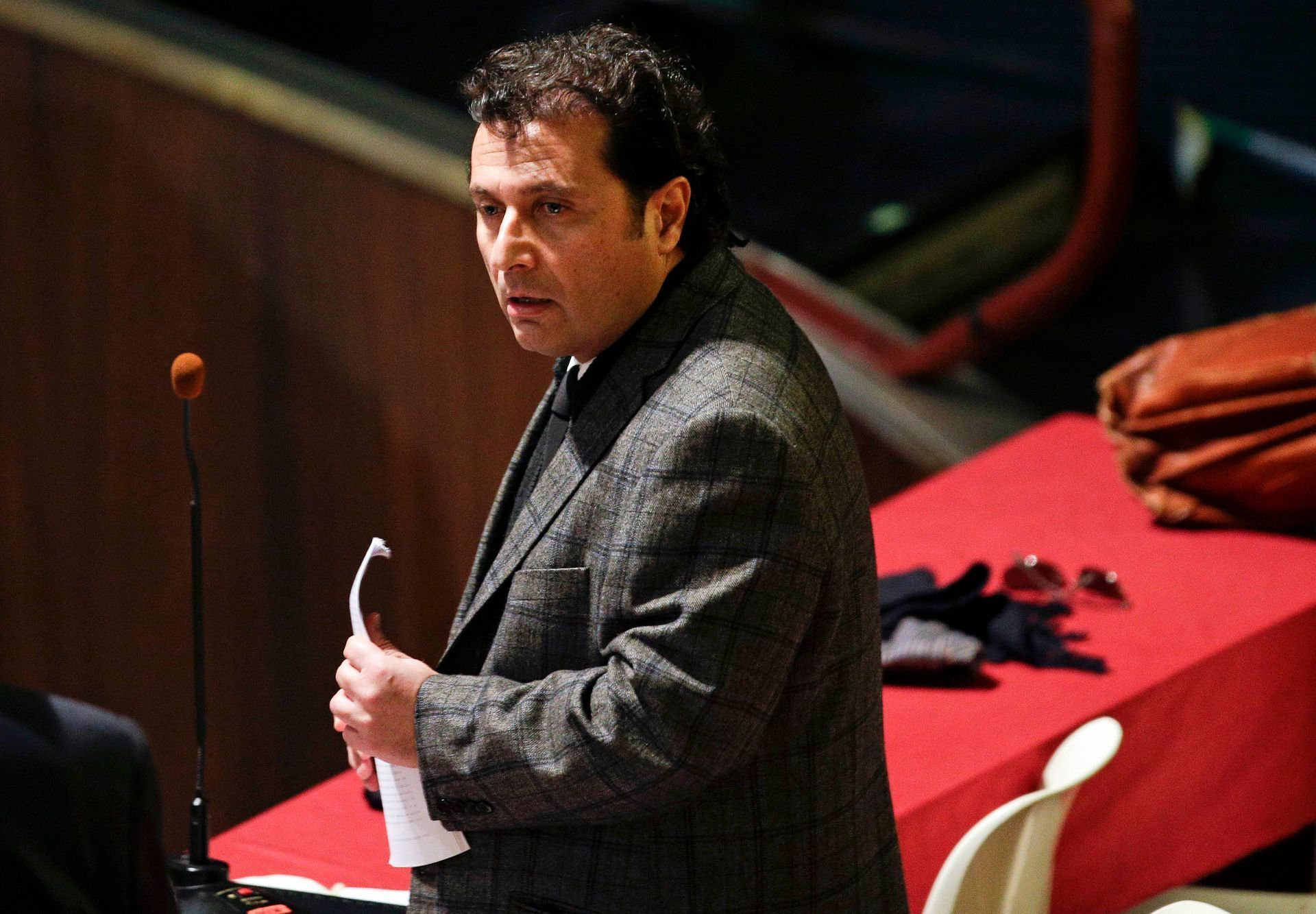 Captain of the Costa Concordia cruise liner Schettino prepares to read a speech during his trial in Grosseto