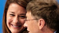 FILE PHOTO: Melinda Gates smiles at husband during the opening news conference for AIDS 2006 in Toronto
