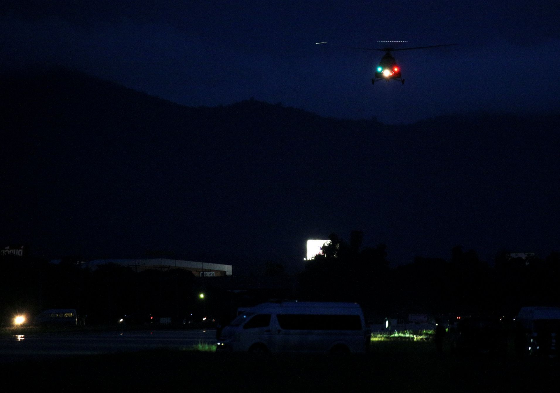 A military helicopter believed to be carrying rescued schoolboys takes off near Tham Luang cave complex in the northern province of Chiang Rai, Thailand