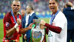 Portugal's Cristiano Ronaldo and Pepe celebrate with the trophy after winning Euro 2016