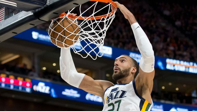 Feb 28, 2020; Salt Lake City, Utah, USA; Utah Jazz center Rudy Gobert (27) dunks the ball during the first half against the Washington Wizards at Vivint Smart Home Arena.