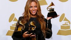 "Beyonce holds the awards she won for Best R&B Performance and Best R&B Song for ""Drunk in Love"" and Best Surround Sound Album for ""Beyonce"" in the press room at the 57th an"