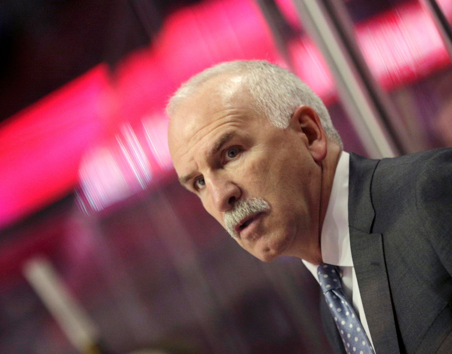 Blackhawks head coach Quenneville directs his team against t