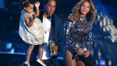 Jay-Z presents the Video Vanguard Award to Beyonce as he holds their daughter Ivy Blue during the 2014 MTV Video Music Awards in Inglewood