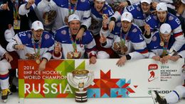 Russia's players celebrate with the trophy after winning their men's ice hockey World Championship final game against Finland at Minsk Arena in Minsk May 25, 2014. REUTER