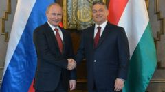 Russia's President Putin shakes hands with Hungarian Prime Minister Orban during their meeting in Budapest