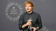 "Singer Ed Sheeran poses backstage after winning the award for best male video for ""Sing"" during the 2014 MTV Video Music Awards in Inglewood"