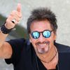 "Cast member Al Pacino gestures as he leaves at the end of the photo call for his two movies ""The Humbling"" and ""Manglehorn"" at the 71st Venice Film Festival"