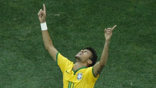 Brazil's Neymar celebrates after scoring a goal from a penalty kick during the 2014 World Cup opening match against Croatia at the Corinthians arena in Sao Paulo June 12,