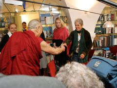 Let's rock'n'roll! Typical Forum 2000. Where Dalai Lama meets Joan Baez