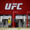 FILE PHOTO: A man walks in front of the Nilson Nelson Gymnasium as the next UFC Fight Night will be held without fans during the fights, after reports of the coronavirus in Brasilia