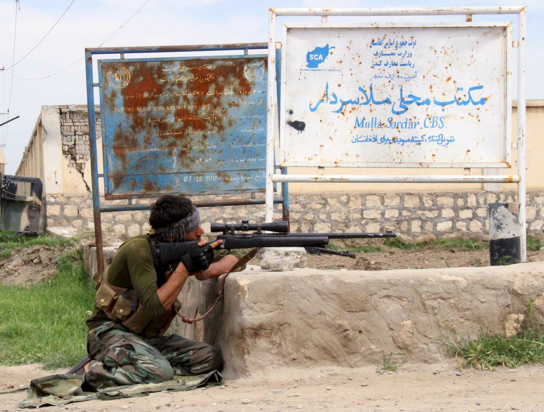 A member of Afghan security force takes his position during a battle with the Taliban on the outskirts of Kunduz province
