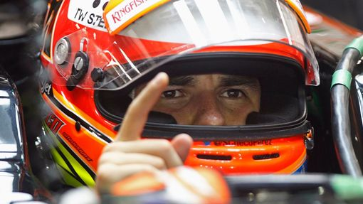 Force India Formula One driver Sergio Perez of Mexico gestures in his car during the second practice session of the Singapore F1 Grand Prix at the Marina Bay street circu