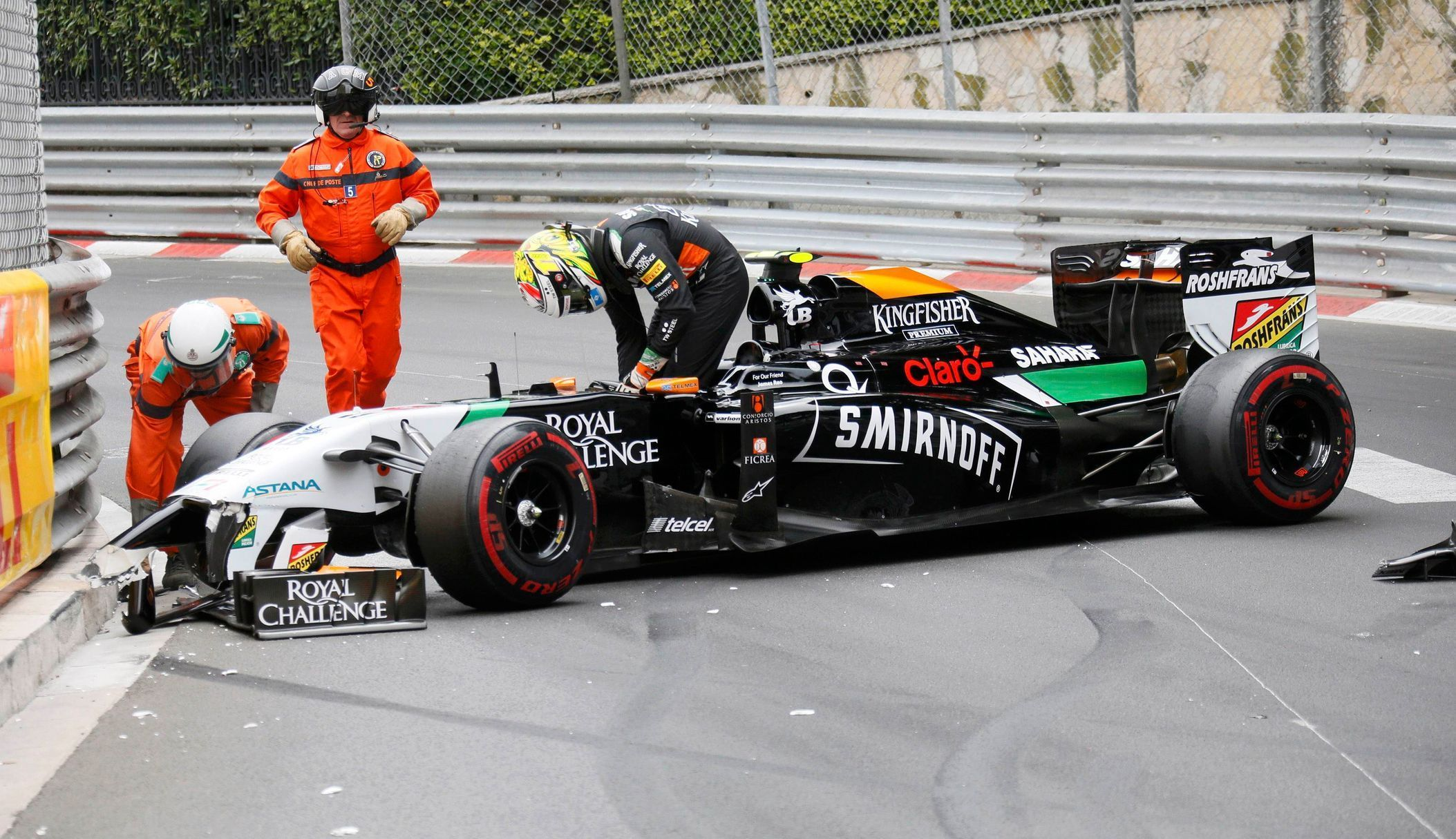 Force India Formula One driver Sergio Perez leaves his car after crashing at the start of the Monaco F1 Grand Prix in Monaco