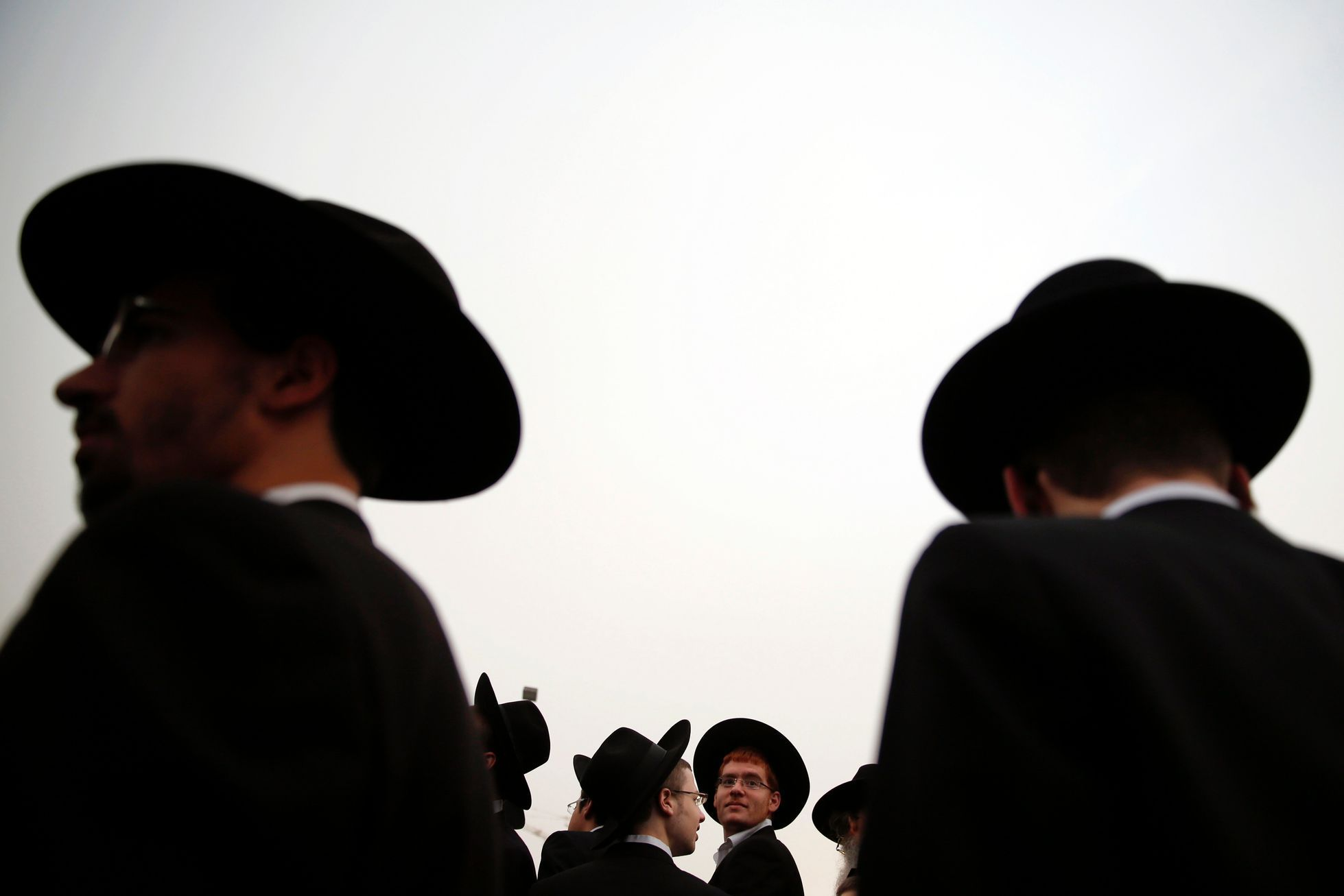 Ultra-Orthodox Jewish men attend a mass prayer in Jerusalem